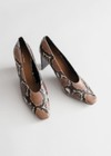 snake skin pattern heeled pumps